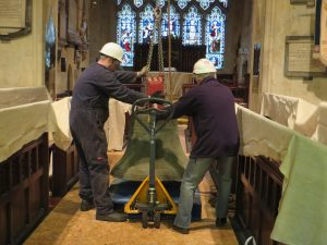Reg and James manoeuvre a bell